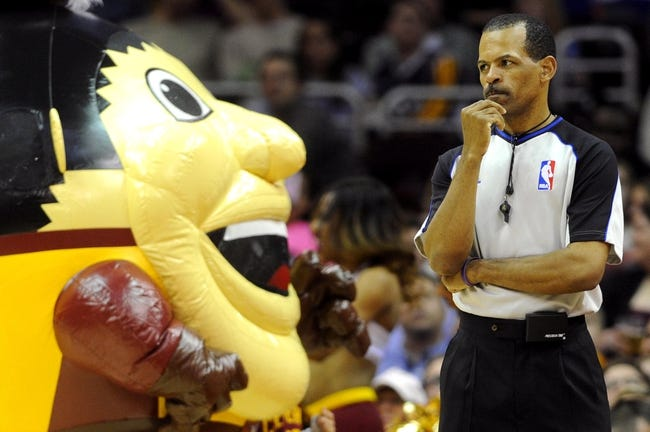 Feb 28, 2014; Cleveland, OH, USA; referee Eric Lewis (42) waits for play to resume during the fourth quarter in the game  between the Cleveland Cavaliers and the Utah Jazz at Quicken Loans Arena. The Cavaliers beat the Jazz 99-79.  Mandatory Credit: Ken Blaze-USA TODAY Sports