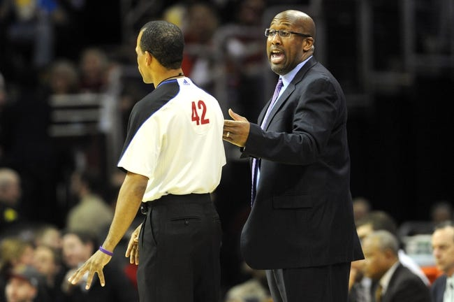 Feb 28, 2014; Cleveland, OH, USA; Cleveland Cavaliers head coach Mike Brown talks with referee Eric Lewis (42) during the third quarter against the Utah Jazz at Quicken Loans Arena. The Cavaliers beat the Jazz 99-79. Mandatory Credit: Ken Blaze-USA TODAY Sports