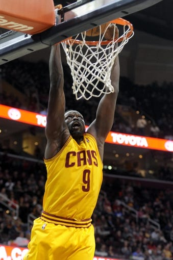 Feb 28, 2014; Cleveland, OH, USA; Cleveland Cavaliers small forward Luol Deng (9) dunks during the first quarter against the Utah Jazz at Quicken Loans Arena. The Cavaliers beat the Jazz 99-79. Mandatory Credit: Ken Blaze-USA TODAY Sports