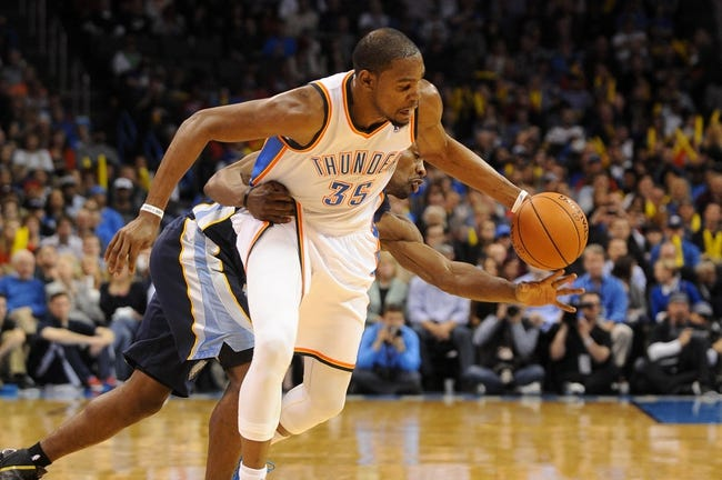 Feb 28, 2014; Oklahoma City, OK, USA; Oklahoma City Thunder small forward Kevin Durant (35) is fouled by Memphis Grizzlies shooting guard Tony Allen (9) during the third quarter at Chesapeake Energy Arena. Mandatory Credit: Mark D. Smith-USA TODAY Sports
