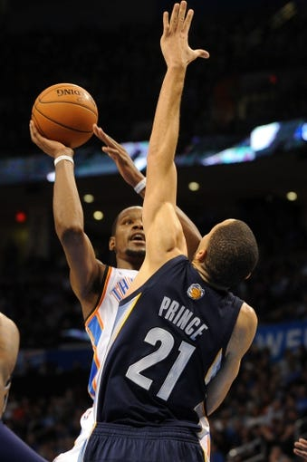 Feb 28, 2014; Oklahoma City, OK, USA; Oklahoma City Thunder small forward Kevin Durant (35) attempts a shot against Memphis Grizzlies small forward Tayshaun Prince (21) during the third quarter at Chesapeake Energy Arena. Mandatory Credit: Mark D. Smith-USA TODAY Sports