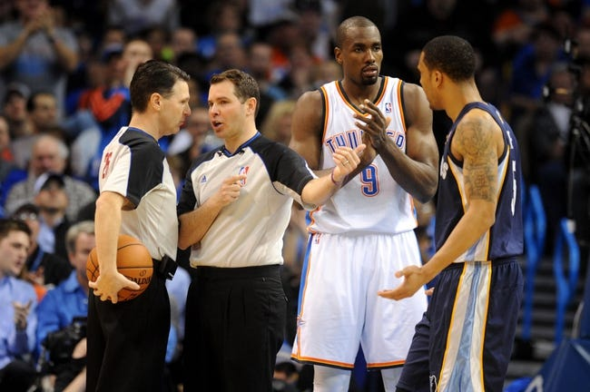 Feb 28, 2014; Oklahoma City, OK, USA; NBA officials Pat Fraher and Brian Forte discuss a call during action between the Oklahoma City Thunder and the Memphis Grizzlies at Chesapeake Energy Arena. Mandatory Credit: Mark D. Smith-USA TODAY Sports