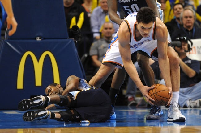 Feb 28, 2014; Oklahoma City, OK, USA; Memphis Grizzlies point guard Mike Conley (11) loses the ball to Oklahoma City Thunder center Steven Adams (12) during the third quarter at Chesapeake Energy Arena. Mandatory Credit: Mark D. Smith-USA TODAY Sports