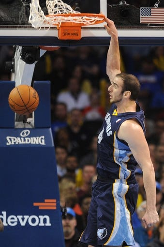 Feb 28, 2014; Oklahoma City, OK, USA; Memphis Grizzlies center Kosta Koufos (41) dunks the ball against the OKlahoam City Thunder during the fourth quarter at Chesapeake Energy Arena. Mandatory Credit: Mark D. Smith-USA TODAY Sports