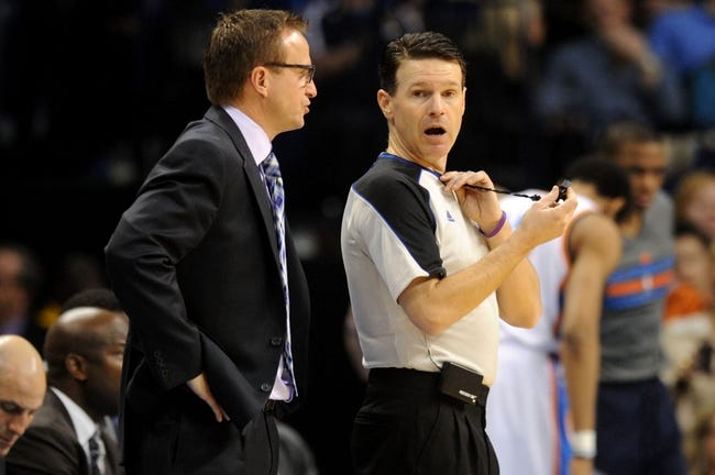 Feb 28, 2014; Oklahoma City, OK, USA; Oklahoma City Thunder head coach Scott Brooks talks to NBA Official Pat Fraher during action against the Memphis Grizzlies at Chesapeake Energy Arena. Mandatory Credit: Mark D. Smith-USA TODAY Sports