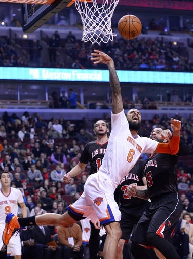Mar 2, 2014; Chicago, IL, USA; Chicago Bulls power forward Carlos Boozer (5) fouls New York Knicks center Tyson Chandler (6) during the first half at the United Center. Mandatory Credit: Mike DiNovo-USA TODAY Sports