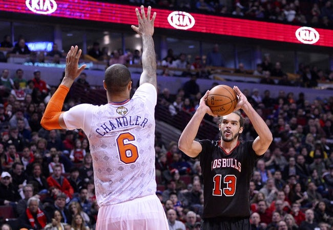 Mar 2, 2014; Chicago, IL, USA; Chicago Bulls center Joakim Noah (13) shoots the ball against New York Knicks center Tyson Chandler (6) during the second half at the United Center. Chicago defeats New York 109-90. Mandatory Credit: Mike DiNovo-USA TODAY Sports