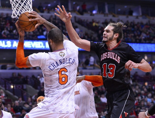 Mar 2, 2014; Chicago, IL, USA; New York Knicks center Tyson Chandler (6) rebounds a ball against Chicago Bulls center Joakim Noah (13) during the second half at the United Center. Chicago defeats New York 109-90. Mandatory Credit: Mike DiNovo-USA TODAY Sports