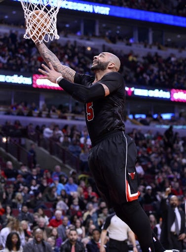 Mar 2, 2014; Chicago, IL, USA; Chicago Bulls power forward Carlos Boozer (5) shoots the ball against the New York Knicks during the second half at the United Center. Chicago defeats New York 109-90. Mandatory Credit: Mike DiNovo-USA TODAY Sports