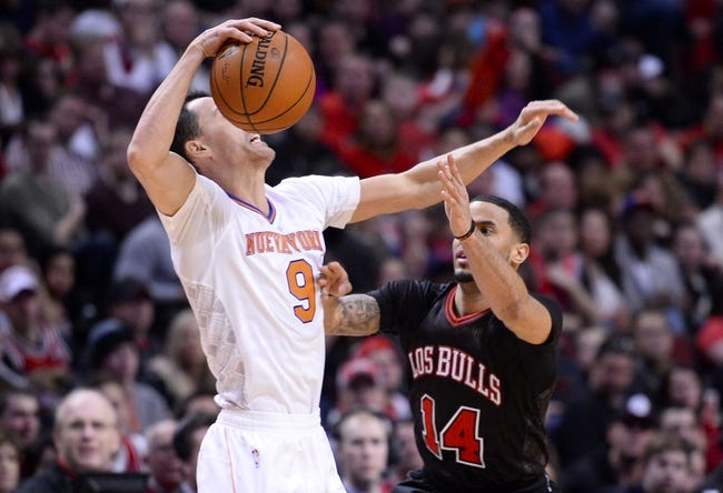 Mar 2, 2014; Chicago, IL, USA; Chicago Bulls point guard D.J. Augustin (14) knocks the ball away from New York Knicks point guard Pablo Prigioni (9) during the second half at the United Center. Chicago defeats New York 109-90. Mandatory Credit: Mike DiNovo-USA TODAY Sports