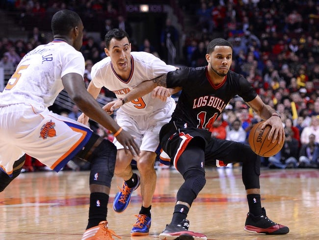 Mar 2, 2014; Chicago, IL, USA; Chicago Bulls point guard D.J. Augustin (14) dribbles the ball against New York Knicks point guard Pablo Prigioni (9) during the second half at the United Center. Chicago defeats New York 109-90. Mandatory Credit: Mike DiNovo-USA TODAY Sports