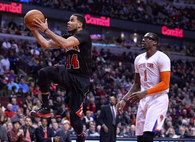 Mar 2, 2014; Chicago, IL, USA; Chicago Bulls point guard D.J. Augustin (14) shoots the ball against New York Knicks power forward Amar'e Stoudemire (1) during the second half at the United Center. Chicago defeats New York 109-90. Mandatory Credit: Mike DiNovo-USA TODAY Sports
