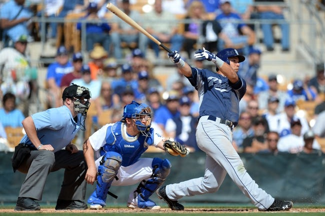 Mar 2, 2014; Phoenix, AZ, USA; San Diego Padres shortstop Jace Peterson (74) hits the ball in the third inning against the Los Angeles Dodgers at Camelback Ranch. Mandatory Credit: Joe Camporeale-USA TODAY Sports