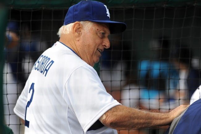 Mar 2, 2014; Phoenix, AZ, USA; Former Los Angeles Dodgers manager Tommy Lasorda (2) looks on against the San Diego Padres at Camelback Ranch. Mandatory Credit: Joe Camporeale-USA TODAY Sports