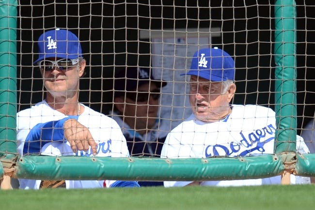 Mar 2, 2014; Phoenix, AZ, USA; Los Angeles Dodgers manager Don Mattingly (8) and former Los Angeles Dodgers manager Tommy Lasorda (2) look on against the San Diego Padres at Camelback Ranch. Mandatory Credit: Joe Camporeale-USA TODAY Sports