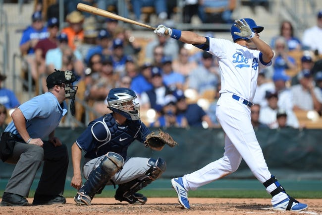 Mar 2, 2014; Phoenix, AZ, USA; Los Angeles Dodgers center fielder Andre Ethier (16) hits the ball in the third inning against the San Diego Padres at Camelback Ranch. Mandatory Credit: Joe Camporeale-USA TODAY Sports