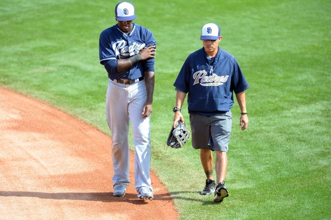 Mar 2, 2014; Phoenix, AZ, USA; San Diego Padres center fielder Cameron Maybin (24) walks off the field against the Los Angeles Dodgers with an injury at Camelback Ranch. Mandatory Credit: Joe Camporeale-USA TODAY Sports