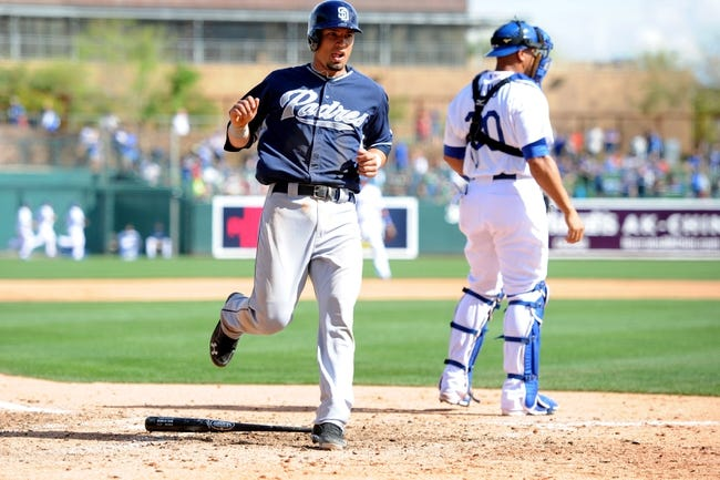 Mar 2, 2014; Phoenix, AZ, USA; San Diego Padres shortstop Jace Peterson (74) scores a run against the Los Angeles Dodgers in the sixth inning at Camelback Ranch. Mandatory Credit: Joe Camporeale-USA TODAY Sports