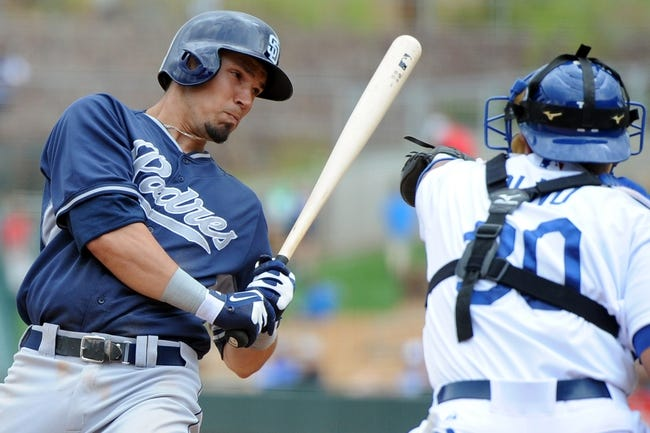 Mar 2, 2014; Phoenix, AZ, USA; San Diego Padres shortstop Jace Peterson (74) is almost hit by the ball in the ninth inning against the Los Angeles Dodgers at Camelback Ranch. Mandatory Credit: Joe Camporeale-USA TODAY Sports