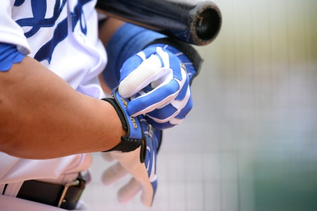 Mar 2, 2014; Phoenix, AZ, USA; Los Angeles Dodgers catcher Miguel Olivo (30) adjusts his gloves against the San Diego Padres in the ninth inning at Camelback Ranch. Mandatory Credit: Joe Camporeale-USA TODAY Sports