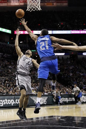 Mar 2, 2014; San Antonio, TX, USA; San Antonio Spurs guard Tony Parker (9) shoots while being defended by Dallas Mavericks guard Wayne Ellington (21) during the first half at AT&T Center. Mandatory Credit: Soobum Im-USA TODAY Sports