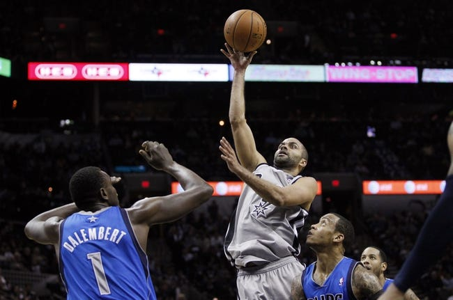 Mar 2, 2014; San Antonio, TX, USA; San Antonio Spurs guard Tony Parker (9) shoots the ball against the Dallas Mavericks during the first half at AT&T Center. Mandatory Credit: Soobum Im-USA TODAY Sports