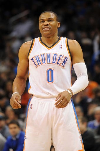 Mar 2, 2014; Oklahoma City, OK, USA; Oklahoma City Thunder point guard Russell Westbrook (0) reacts to a play in action against the Charlotte Bobcats during the second quarter at Chesapeake Energy Arena. Mandatory Credit: Mark D. Smith-USA TODAY Sports