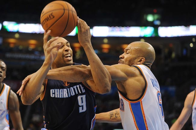 Mar 2, 2014; Oklahoma City, OK, USA; Charlotte Bobcats shooting guard Gerald Henderson (9) is fouled by Oklahoma City Thunder point guard Derek Fisher (6) during the second quarter at Chesapeake Energy Arena. Mandatory Credit: Mark D. Smith-USA TODAY Sports