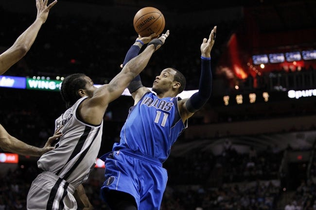 Mar 2, 2014; San Antonio, TX, USA; Dallas Mavericks guard Monta Ellis (11) takes a shot over San Antonio Spurs forward Kawhi Leonard (left) during the second half at AT&T Center. Mandatory Credit: Soobum Im-USA TODAY Sports