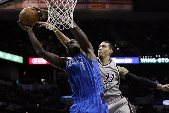 Mar 2, 2014; San Antonio, TX, USA; Dallas Mavericks center Samuel Dalembert (1) shots the ball past San Antonio Spurs guard Danny Green (behind) during the second half at AT&T Center. Mandatory Credit: Soobum Im-USA TODAY Sports