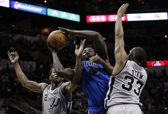 Mar 2, 2014; San Antonio, TX, USA; Dallas Mavericks center DeJuan Blair (45) shoots while being defended by San Antonio Spurs forward Kawhi Leonard (2) and Boris Diaw (33) during the second half at AT&T Center. Mandatory Credit: Soobum Im-USA TODAY Sports