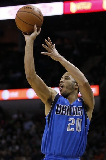 Mar 2, 2014; San Antonio, TX, USA; Dallas Mavericks guard Devin Harris (20) shoots the ball against the San Antonio Spurs during the second half at AT&T Center. Mandatory Credit: Soobum Im-USA TODAY Sports