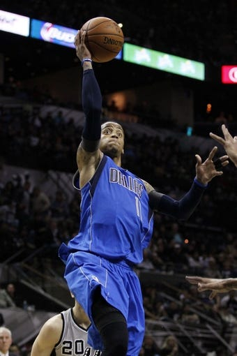 Mar 2, 2014; San Antonio, TX, USA; Dallas Mavericks guard Monta Ellis (11) shoots the ball against the San Antonio Spurs during the second half at AT&T Center. Mandatory Credit: Soobum Im-USA TODAY Sports