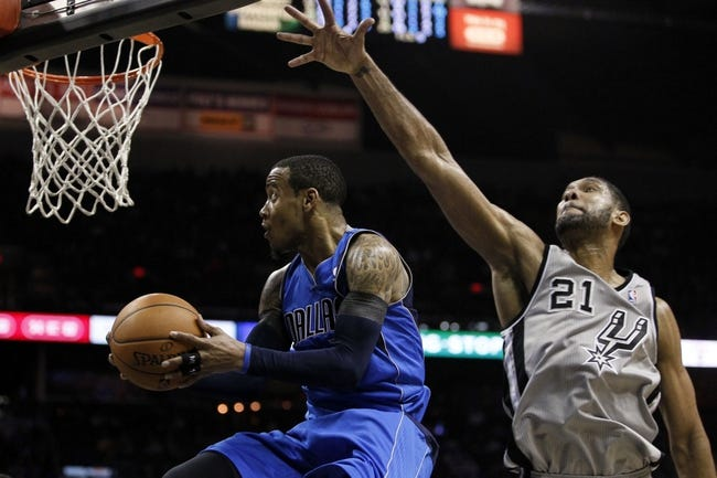 Mar 2, 2014; San Antonio, TX, USA; Dallas Mavericks guard Monta Ellis (11) shoots the ball past San Antonio Spurs forward Tim Duncan (21) during the second half at AT&T Center. Mandatory Credit: Soobum Im-USA TODAY Sports