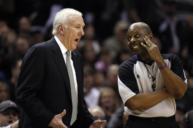 Mar 2, 2014; San Antonio, TX, USA; San Antonio Spurs head coach Gregg Popovich argues a call with referee Derek Richardson during the second half against the Dallas Mavericks at AT&T Center. The Spurs won 112-106. Mandatory Credit: Soobum Im-USA TODAY Sports