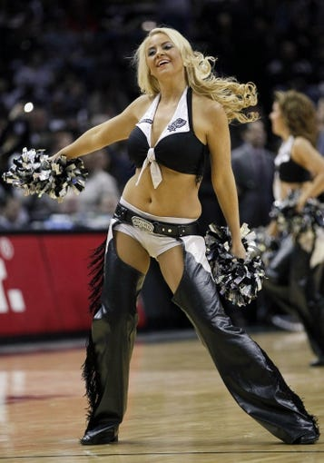 Mar 2, 2014; San Antonio, TX, USA; San Antonio Spurs cheerleader performs during the first half against the Dallas Mavericks at AT&T Center. Mandatory Credit: Soobum Im-USA TODAY Sports