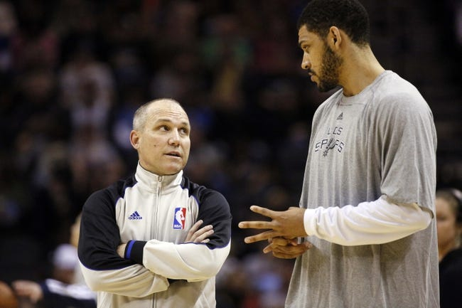 Mar 2, 2014; San Antonio, TX, USA; San Antonio Spurs forward Jeff Ayres (11) talks with a referee Ron Garretson before the game against the Dallas Mavericks at AT&T Center. Mandatory Credit: Soobum Im-USA TODAY Sports