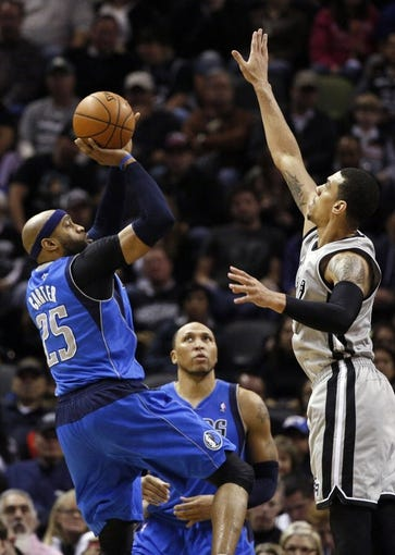Mar 2, 2014; San Antonio, TX, USA; Dallas Mavericks guard Vince Carter (25) takes a shot over San Antonio Spurs guard Danny Green (right) during the first half at AT&T Center. Mandatory Credit: Soobum Im-USA TODAY Sports