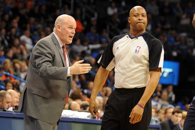 Mar 2, 2014; Oklahoma City, OK, USA; Charlotte Bobcats head coach Steve Clifford speaks to NBA official Olandis Poole in action against the Oklahoma City Thunder at Chesapeake Energy Arena. Mandatory Credit: Mark D. Smith-USA TODAY Sports