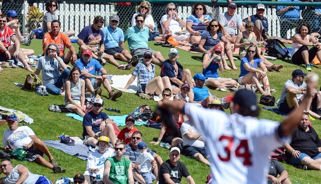 Mar 3, 2014; Lake Buena Vista, FL, USA; Fans look on as Atlanta Braves pitcher Freddy Garcia (34) throws a pitch  in the first inning of the spring training exhibition game against the New York Mets at Champion Stadium. Mandatory Credit: Jonathan Dyer-USA TODAY Sports