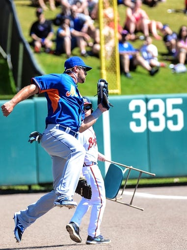 Mar 3, 2014; Lake Buena Vista, FL, USA; New York Mets outfielder Kirk Nieuwenhuis (9) catches a foul ball during the spring training exhibition game against the Atlanta Braves at Champion Stadium. Mandatory Credit: Jonathan Dyer-USA TODAY Sports