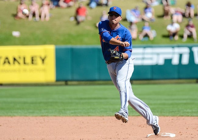 Mar 3, 2014; Lake Buena Vista, FL, USA; New York Mets second basemen Wilmer Flores (4) makes a throw  during the spring training exhibition game against the Atlanta Braves at Champion Stadium. Mandatory Credit: Jonathan Dyer-USA TODAY Sports