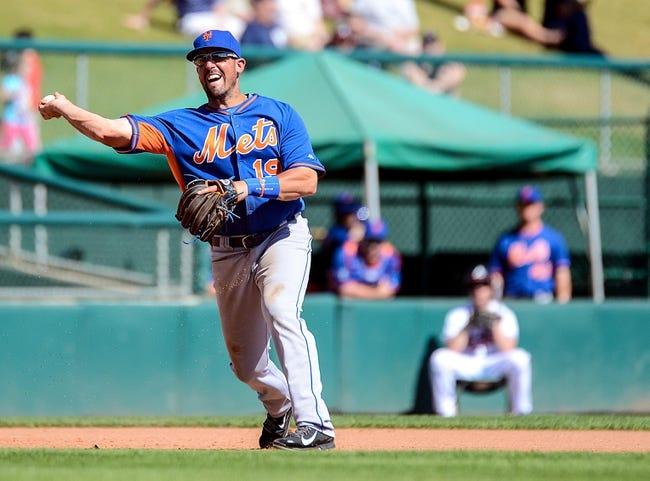 Mar 3, 2014; Lake Buena Vista, FL, USA; New Yorks Mets third basemen Zach Lutz (19) makes a throw during the spring training exhibition game against the Atlanta Braves at Champion Stadium. Mandatory Credit: Jonathan Dyer-USA TODAY Sports