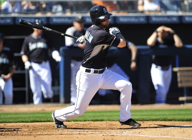 March 3, 2014; Peoria, AZ, USA; Seattle Mariners second baseman Nick Franklin (6) at bat in the second in the first inning against the Colorado Rockies at Peoria Sports Complex. Mandatory Credit: Gary A. Vasquez-USA TODAY Sports