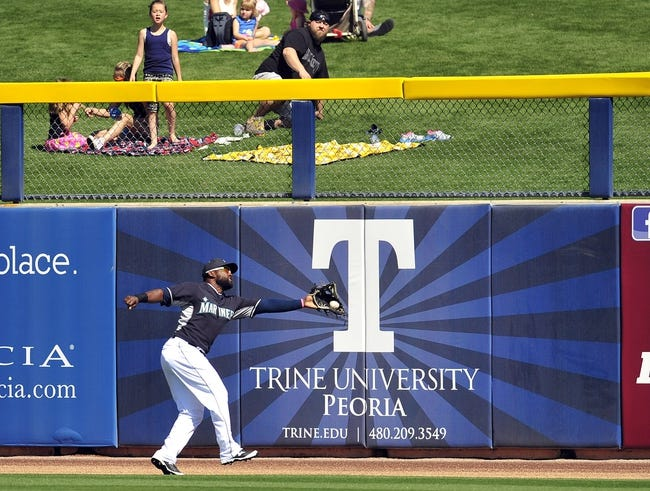 March 3, 2014; Peoria, AZ, USA; Seattle Mariners center fielder Abraham Almonte (36) catches a fly ball in the third inning against the Colorado Rockies at Peoria Sports Complex. Mandatory Credit: Gary A. Vasquez-USA TODAY Sports
