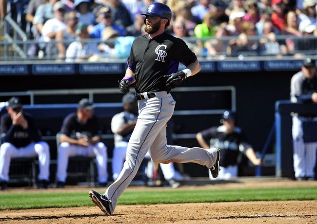 March 3, 2014; Peoria, AZ, USA; Colorado Rockies right fielder Charlie Blackmon (19) scores a run in the third inning against the Seattle Mariners at Peoria Sports Complex. Mandatory Credit: Gary A. Vasquez-USA TODAY Sports