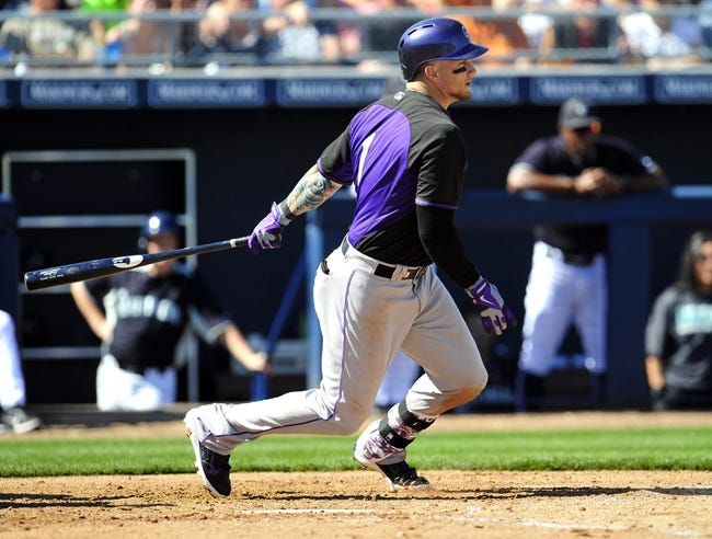 March 3, 2014; Peoria, AZ, USA; Colorado Rockies center fielder Brandon Barnes (1) hits an RBI single in the third inning against the Seattle Mariners at Peoria Sports Complex. Mandatory Credit: Gary A. Vasquez-USA TODAY Sports