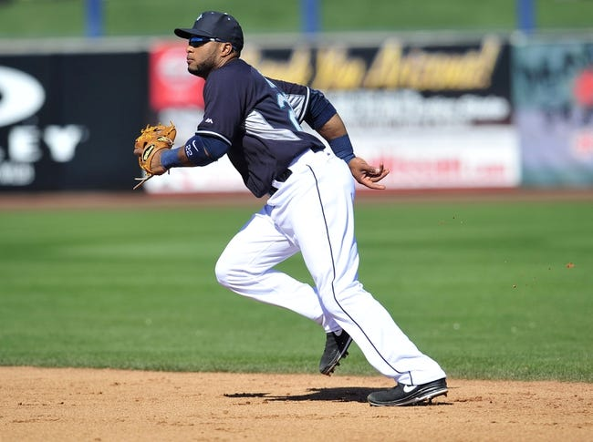 March 3, 2014; Peoria, AZ, USA; Seattle Mariners second baseman Robinson Cano (22) in defensive position against the Colorado Rockies at Peoria Sports Complex. Mandatory Credit: Gary A. Vasquez-USA TODAY Sports