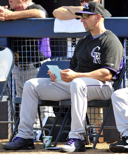 March 3, 2014; Peoria, AZ, USA; Colorado Rockies manager Walt Weiss (22) watches game action against the Seattle Mariners at Peoria Sports Complex. Mandatory Credit: Gary A. Vasquez-USA TODAY Sports