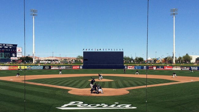 March 3, 2014; Peoria, AZ, USA; General view of game action as the Seattle Mariners play against the Colorado Rockies at Peoria Sports Complex. Mandatory Credit: Gary A. Vasquez-USA TODAY Sports